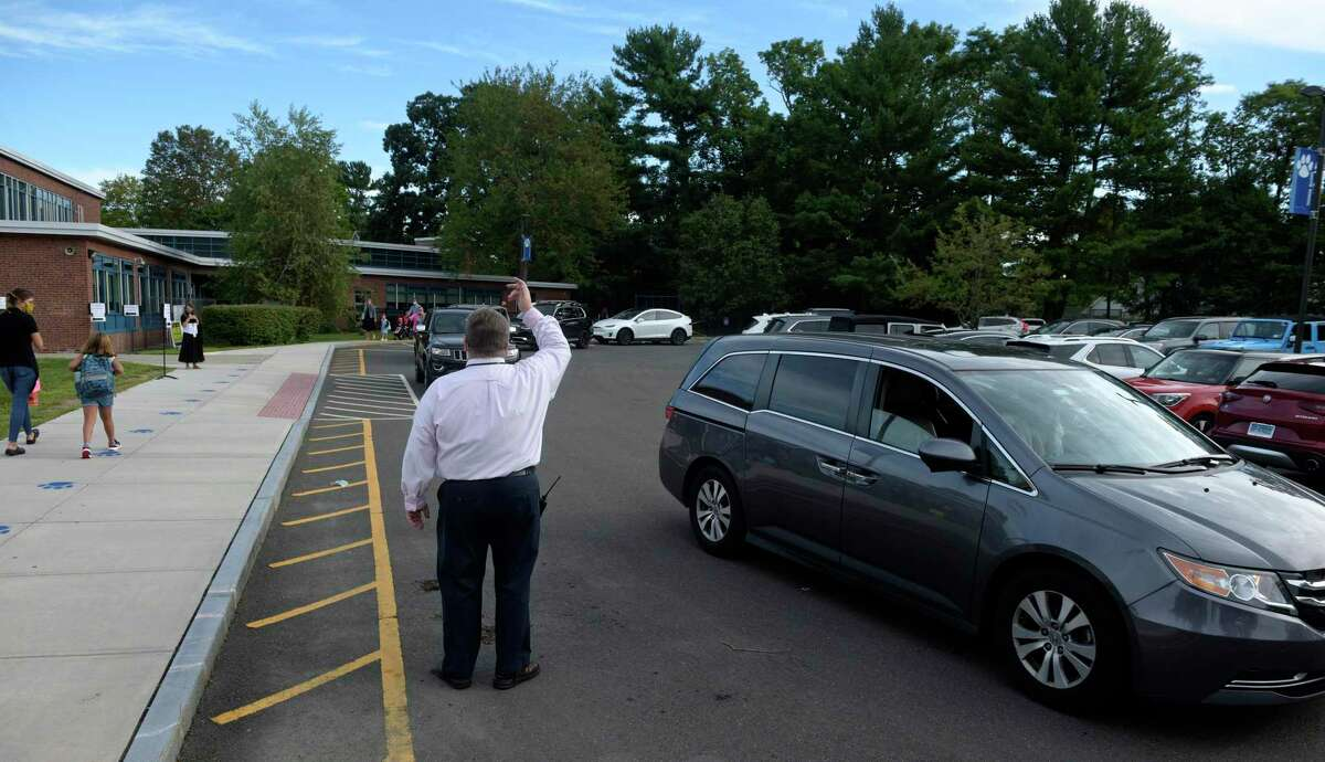 Principal Matthew Kaseau keeps the drop off line moving on the first day of the new school year at South Elementary School in New Canaan, Connecticut, at the start of this 2020-21 school year. This letter is from a member of the town's council, who praises the town's schools' for being able to open, and soon be able to offer classes in-person five days a week.