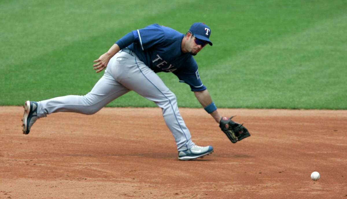 Texas Rangers shortstop Ramon Vazquez makes a play on a ball hit by Cleveland Indians' Jhonny Peralta in a 2007 game. Vazquez hit .286 with 37 extra-base hits to help the New Haven Ravens win the 2000 Eastern League title.