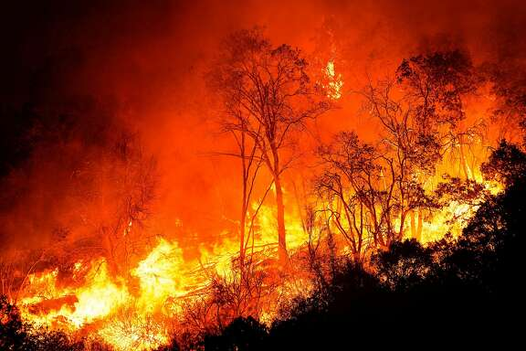 FRESNO COUNTY, CA - SEPTEMBER 08: The Creek Fire jumps CA-168 on Tuesday, Sept. 8, 2020 in Fresno County, CA. (Kent Nishimura / Los Angeles Times/TNS)