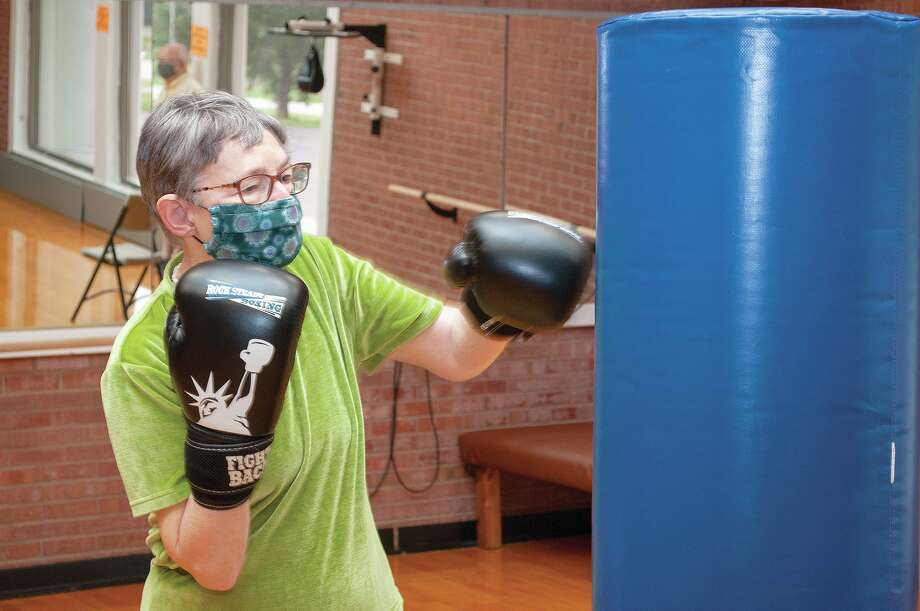 Fran Ringle has been battling Parkinson's disease for three years. Last year, both Fran and her husband, Jim, started attending the Rock Steady Boxing class at Bob Freesen YMCA. The class helps people with Parkinson's work on coordination, hand movement, balance and overall health. Photo: Darren Iozia | Journal-Courier / Jacksonville Journal-Courier