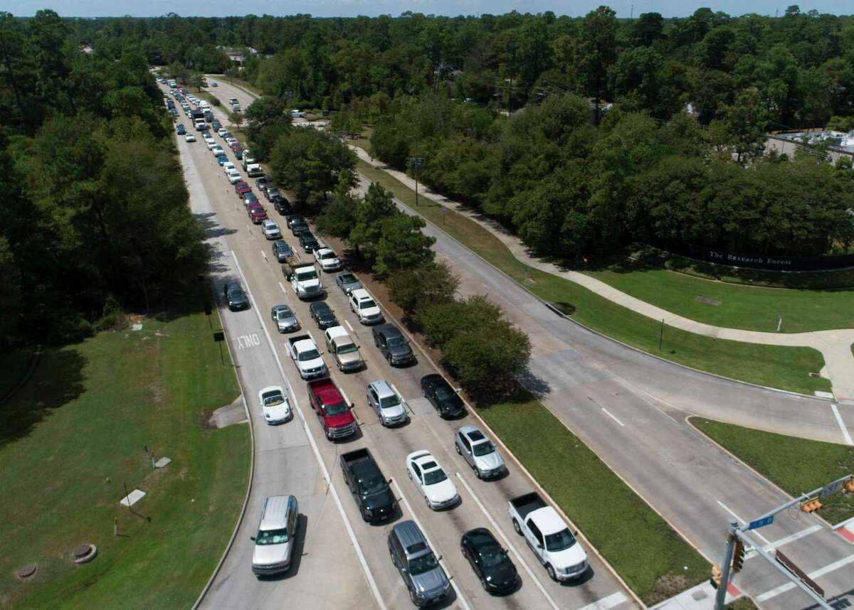Vehicles clog Research Forest Drive near Interstate 45 after power to many of the area's traffic lights went out on Aug. 27, 2020. A new study estimates making all vehicles electric could save 148 annually in Houston.