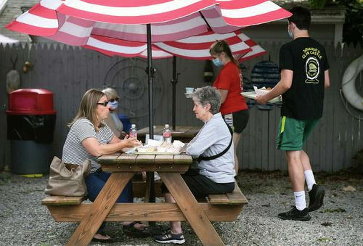 Sara Pierson (left) of Madison has lunch with her mother, Virginia Czaplicki, of Clinton at The Clam Castle on the Post Road in Madison on September 11, 2020.