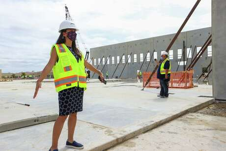 Athletic director Lisa Campos leads a construction update tour of UTSA's Roadrunner Athletics Center for Excellence on Sept. 11. The $41.5 million facility is on schedule to be completed in the summer of 2021.