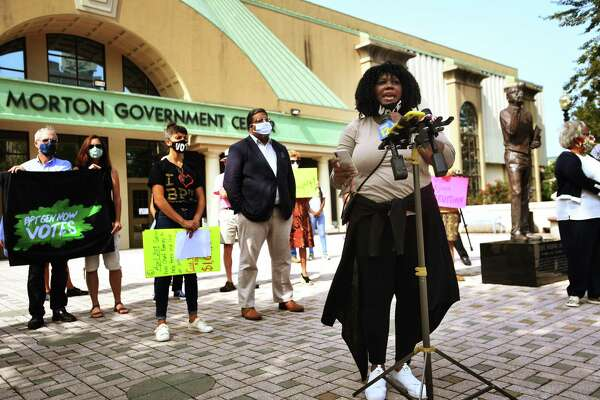 Gemeem Davis, co-director of Bridgeport Generation Now, calls for the resignation of Mayor Joe Ganim during a protest outside the Margaret E. Morton Government Center in Bridgeport on Monday.