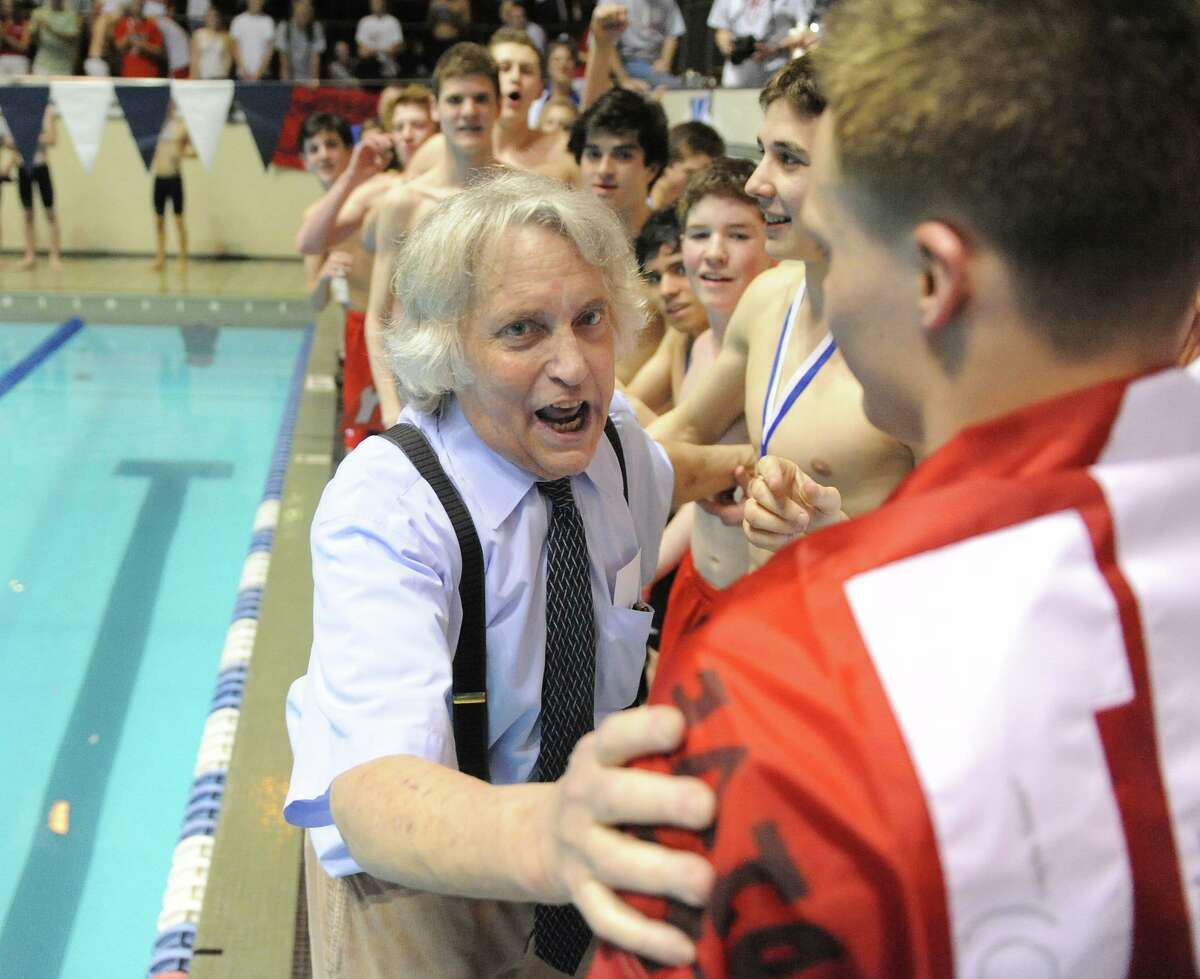 Bruce Jaffe, Fairfield Prep swim coach, congratulates his team after they won the Boys CIAC State Open Swimming championships at Yale University in New Haven, Conn., Saturday, March 17, 2012.