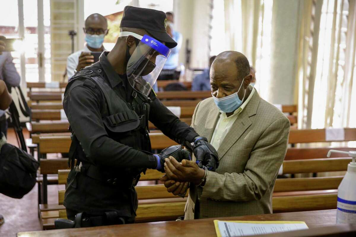 Hero accused of terrorism A policeman handcuffs Paul Rusesabagina, right, whose story inspired the film