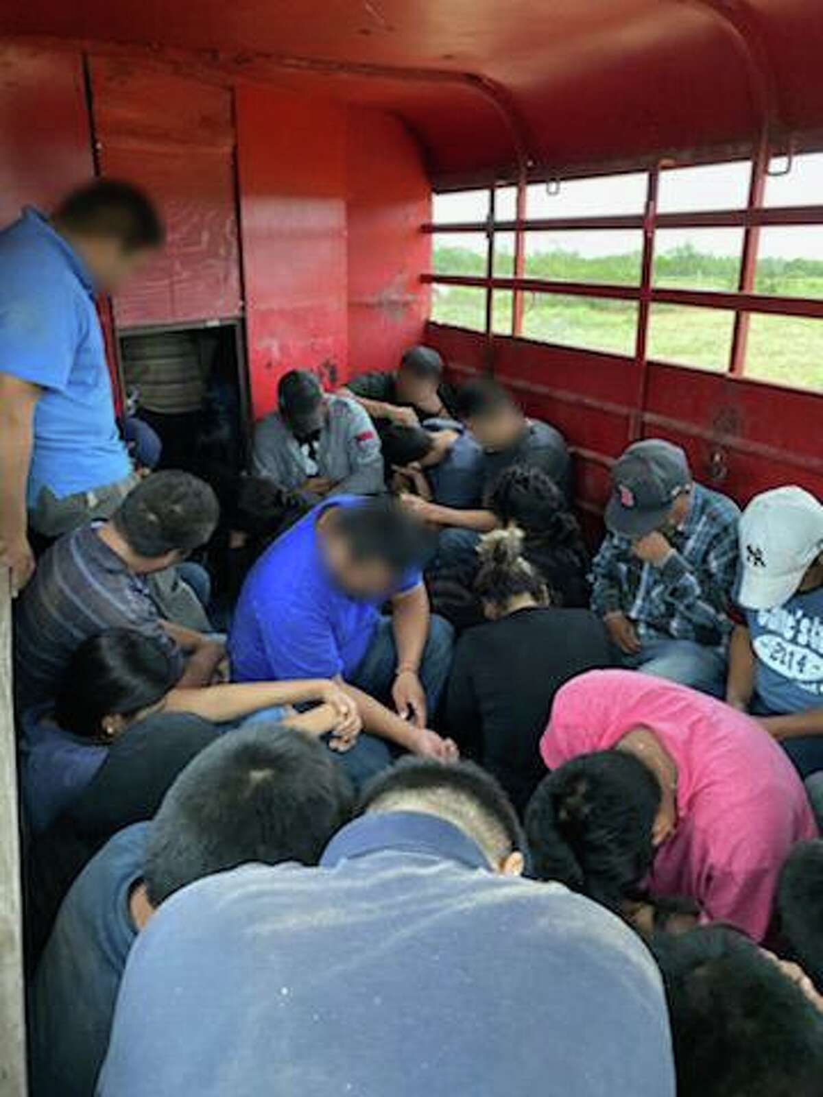A total of 42 immigrants are from Mexico and Honduras are pictured inside a horse trailer discovered last Thursday.