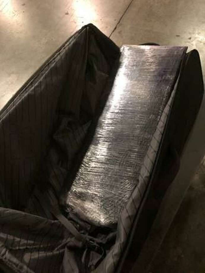 A total of 16 pounds of meth are shown after being seized in Laredo following a traffic stop near Loop 20 and Mines Road. Photo: Courtesy /Texas Department Of Public Safety