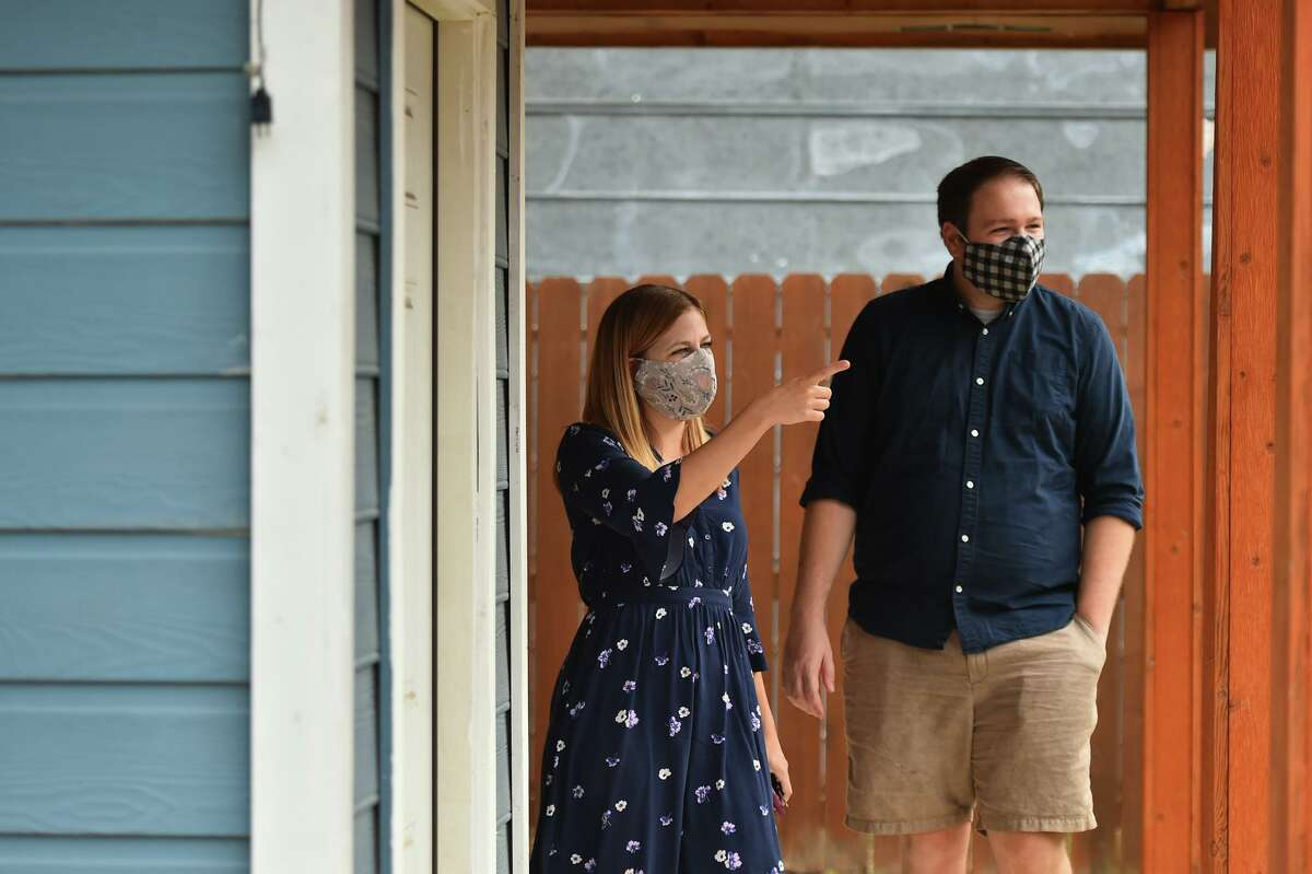 San Antonio Express-News reporter Madison Iszler and her husband James Grover visit an open house during the coronavirus pandemic.