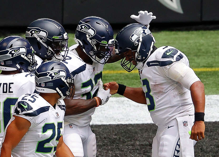 ATLANTA, GEORGIA - SEPTEMBER 13: Russell Wilson #3 of the Seattle Seahawks celebrates with Chris Carson #32 after a touchdown against the Atlanta Falcons at Mercedes-Benz Stadium on September 13, 2020 in Atlanta, Georgia. (Photo by Kevin C. Cox/Getty Images) Photo: Kevin C. Cox/Getty Images / 2020 Getty Images
