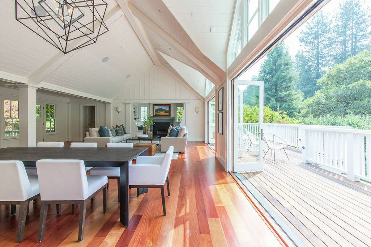 The dining area opens completely onto a deck.