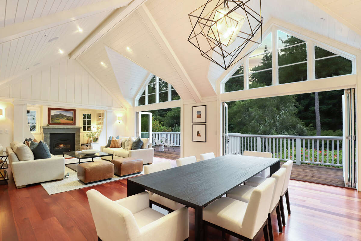 The main house, which offers five bedrooms and four and a half baths, has soaring ceilings, hardwood and glass, and custom millwork throughout.
