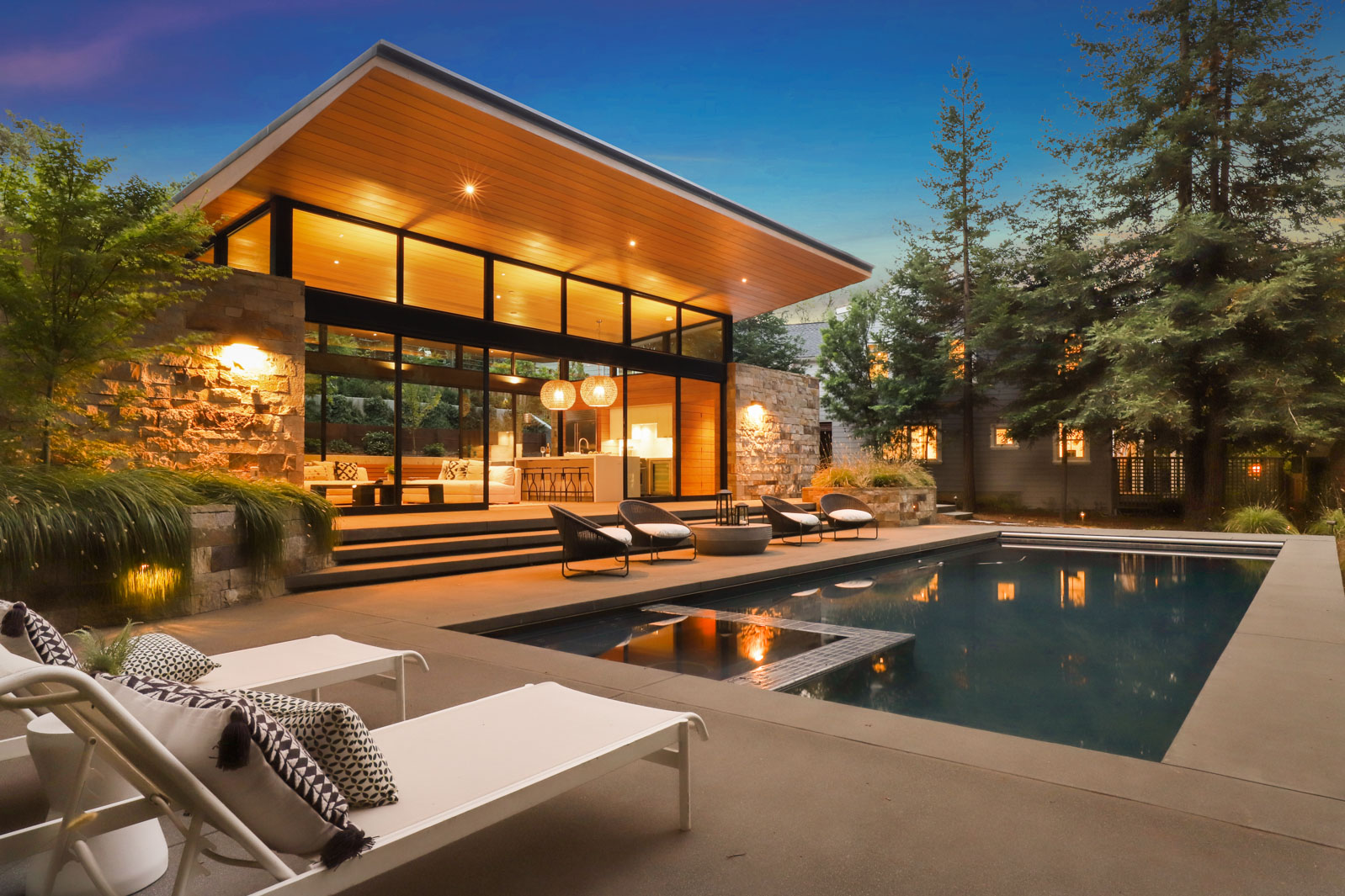 This is the pool house, a gleaming, modern and eco-friendly masterpiece on the property.