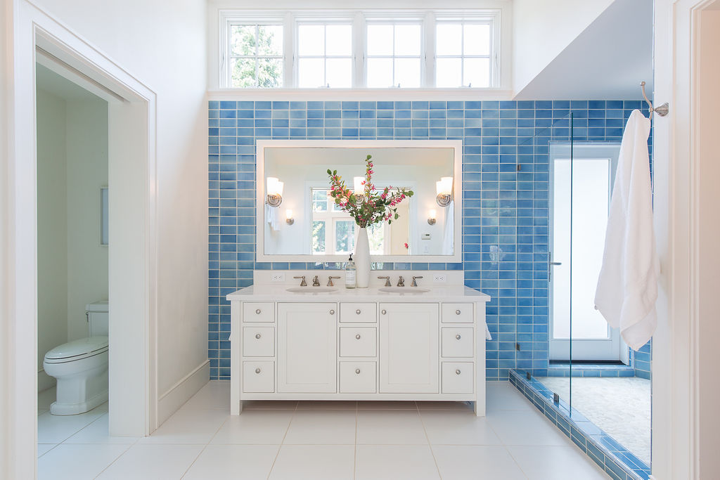 The main house bath is bright and spacious.