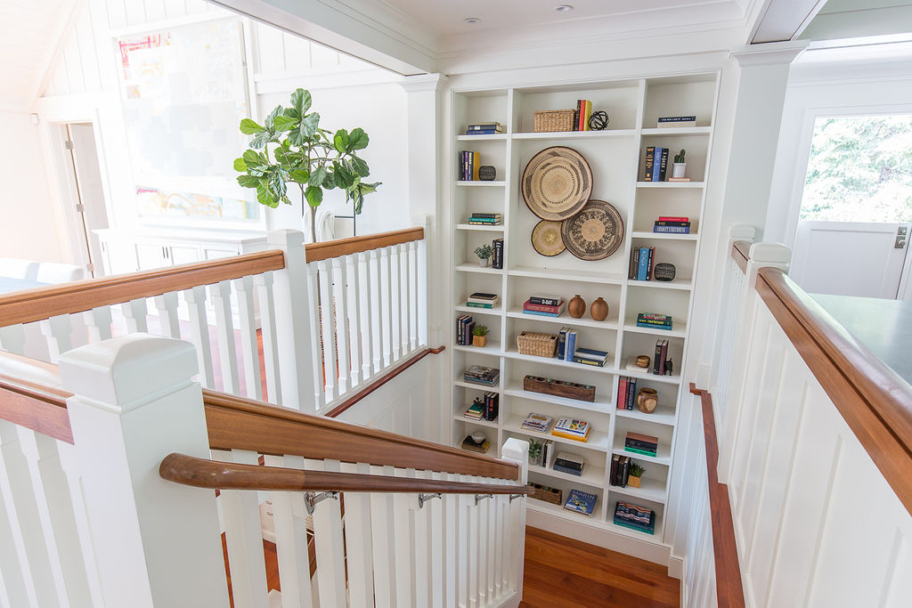 The main house has two levels. Here we see the built-ins, of which there are many in this home, on the staircase landing.