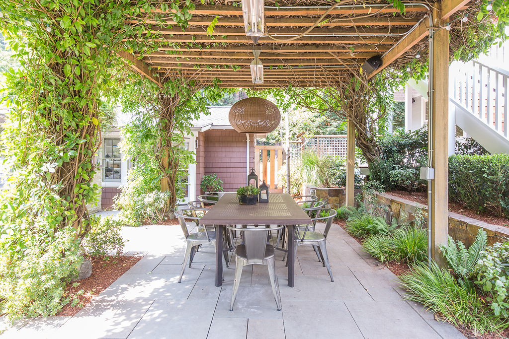 You can dine under climbing vines. The outdoor area is heated and flanked by fruit trees (orange, lime, Meyer lemon, apple, Asian pears) and and berry bushes.