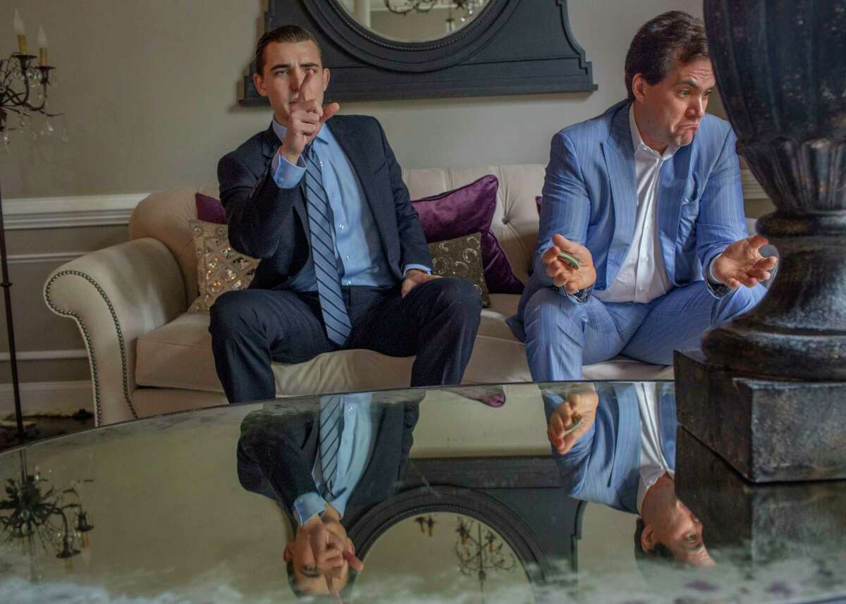 Jack Burkman, light blue suit, and Jacob Wohl, dark suit, in Burkman's home/office in Arlington, Va., in May 2019.
