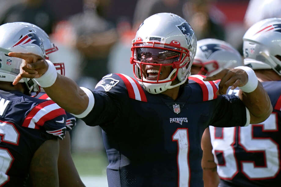 New England Patriots quarterback Cam Newton signals a first down in the second half of an NFL football game against the Miami Dolphins, Sunday, Sept. 13, 2020, in Foxborough, Mass. (AP Photo/Steven Senne) Photo: Steven Senne / Copyright 2020 The Associated Press. All rights reserved