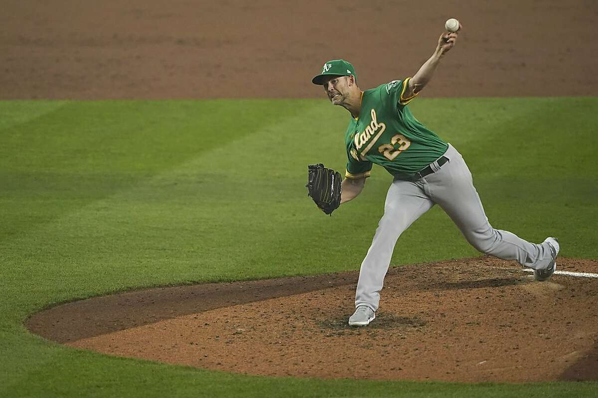 Oakland Athletics starting pitcher Mike Minor thows against the Seattle Mariners during the third inning of the second baseball game of a doubleheader, Monday, Sept. 14, 2020, in Seattle. (AP Photo/Ted S. Warren)