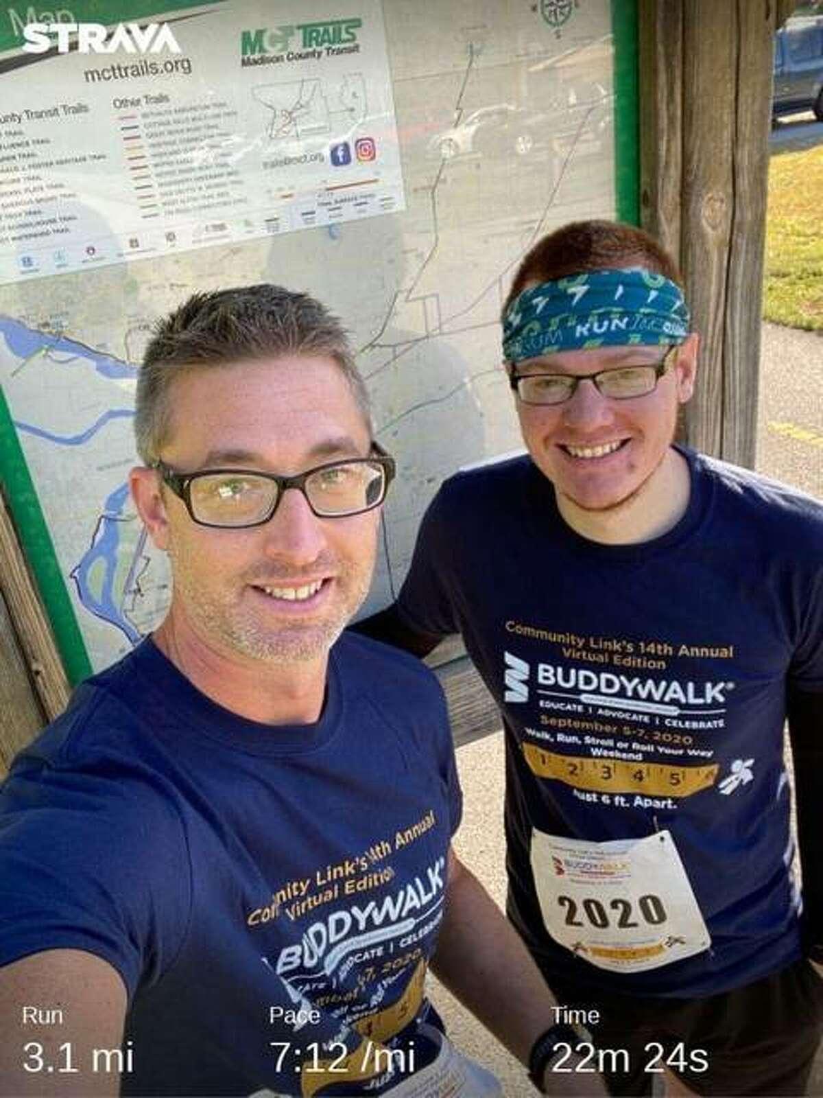 Brandon and Josh Baquet run the Virtual Buddy Walk 5K at Madison County Transit Trails.