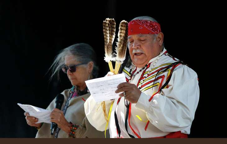 Linda Ximenes, Tribal Council Manner and Miguel Acosta ,Ceremonial Leader lead off with a prayer. Members of Tap Pilam Coahuiltecan Nation will provide several cultural performances, including an elder opening, River Singers, powwow dancers and Aztec dancers, inside the Bud Light courtyard on Sunday, January 19, 2020 at At&T Center.
