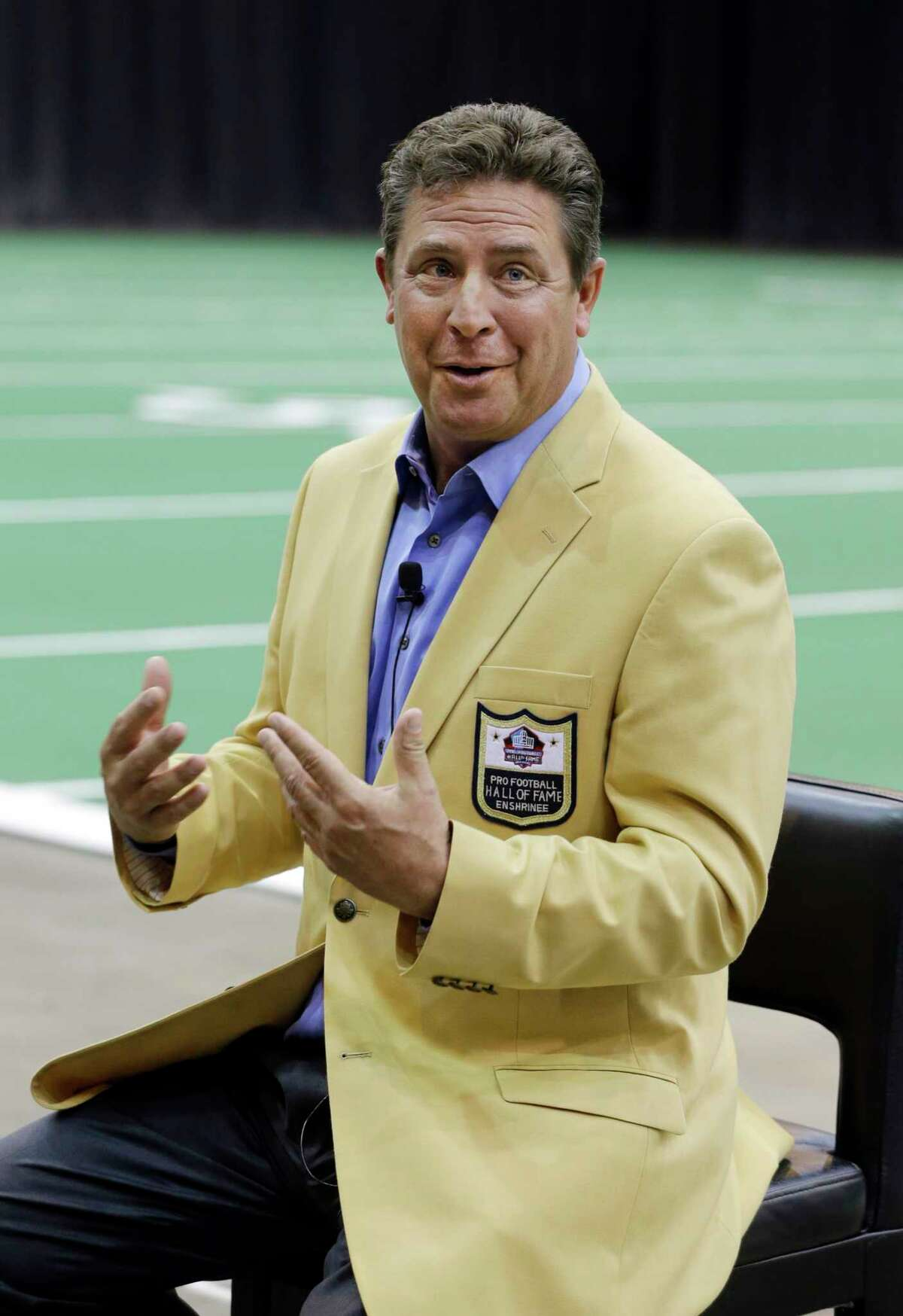 Miami Dolphins' Hall of Fame quarterback Dan Marino speaks at a news conference promoting the Pro Football Hall of Fame fanfest at the I-X Center in Cleveland Tuesday, April 29, 2014. The inaugural event will allow fans to meet and interact with 100 members of the Pro Football Hall of Fame May 3-4, 2014. (AP Photo) ORG XMIT: OHMD114