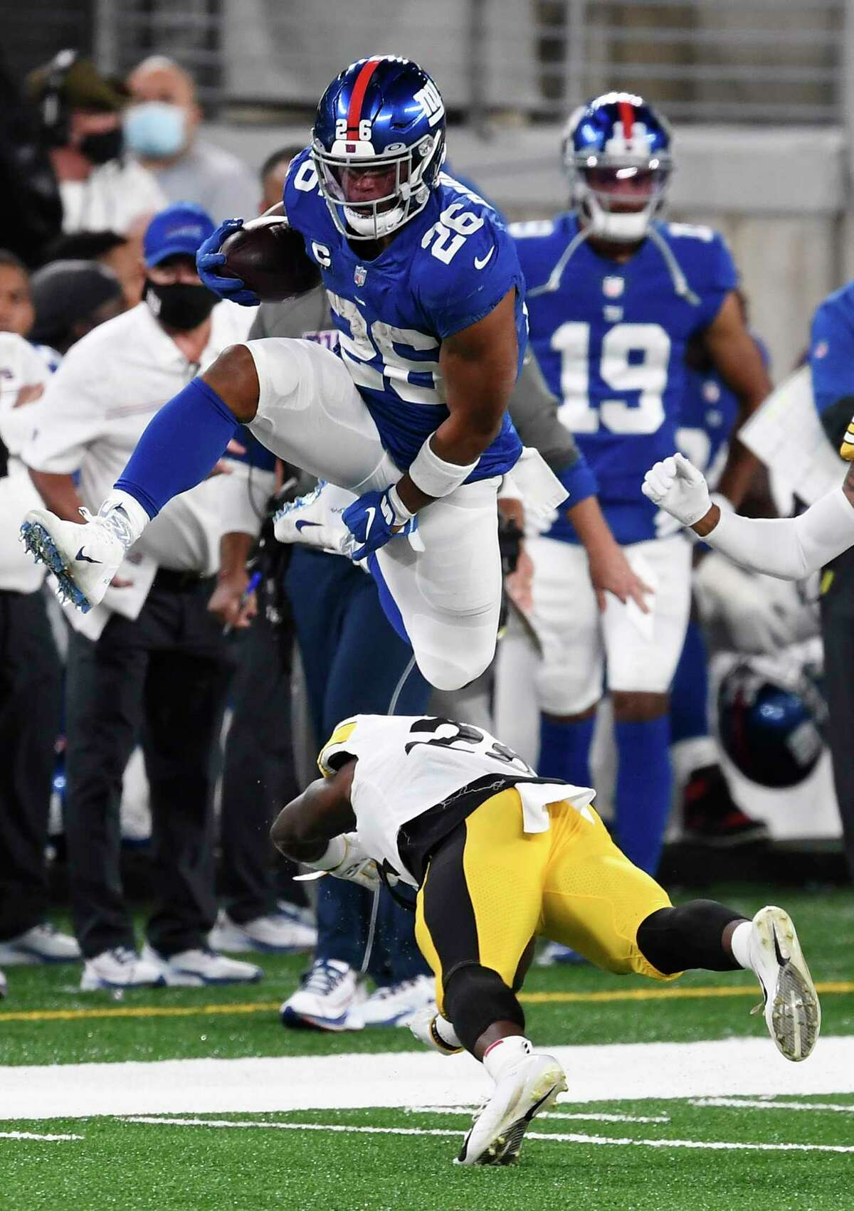 EAST RUTHERFORD, NEW JERSEY - SEPTEMBER 14: Saquon Barkley #26 of the New York Giants leaps over Mike Hilton #28 of the Pittsburgh Steelers defends during the first half at MetLife Stadium on September 14, 2020 in East Rutherford, New Jersey. (Photo by Sarah Stier/Getty Images)