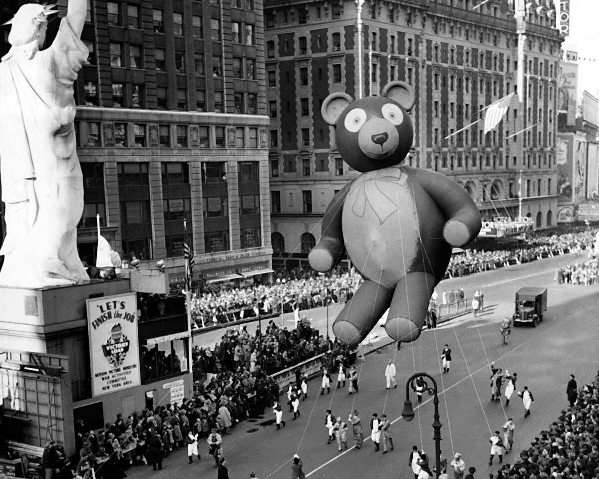 FILE - In this Nov. 23, 1945 file photo a float is paraded through New York's Times Square during the annual Macy's Thanksgiving Day Parade, the first parade since the festivities were suspended during World War II. A Macy's Thanksgiving parade reimagined for the coronavirus pandemic will feature floats, performers and giant balloons parading along a one-block stretch of 34th Street in front of the retailer's flagship Manhattan store, Macy's officials announced Monday, Sept. 14, 2020. (AP Photo, File)