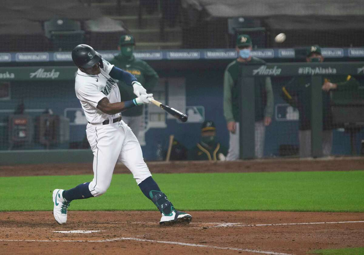 SEATTLE, WA - SEPTEMBER 14: Kyle Lewis #1 of the Seattle Mariners hits a two-run home run in the fifth inning against the Oakland Athletics in the first game of a doubleheader at T-Mobile Park on September 14, 2020 in Seattle, Washington. (Photo by Lindsey Wasson/Getty Images)