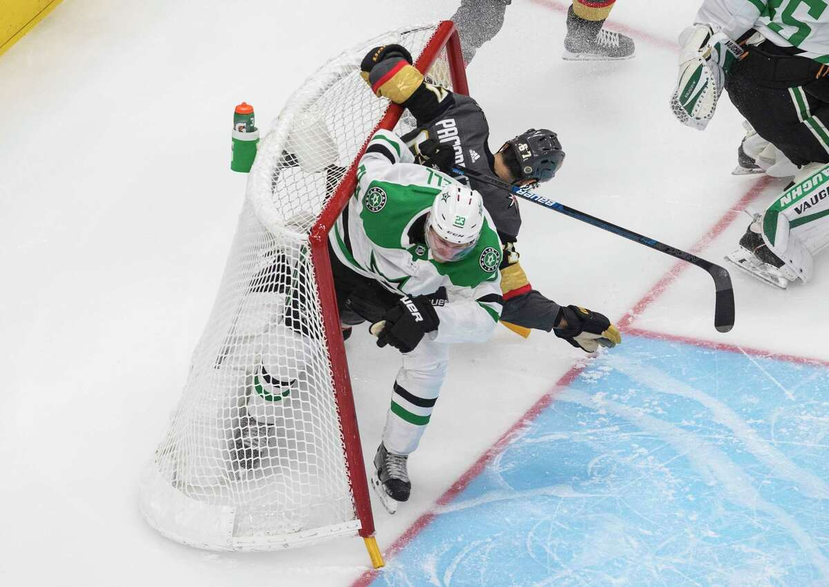 Dallas Stars' Esa Lindell (23) and Vegas Golden Knights' Max Pacioretty (67) crash into the net during second-period NHL Western Conference final playoff game action in Edmonton, Alberta, Monday, Sept. 14, 2020. (Jason Franson/The Canadian Press via AP)