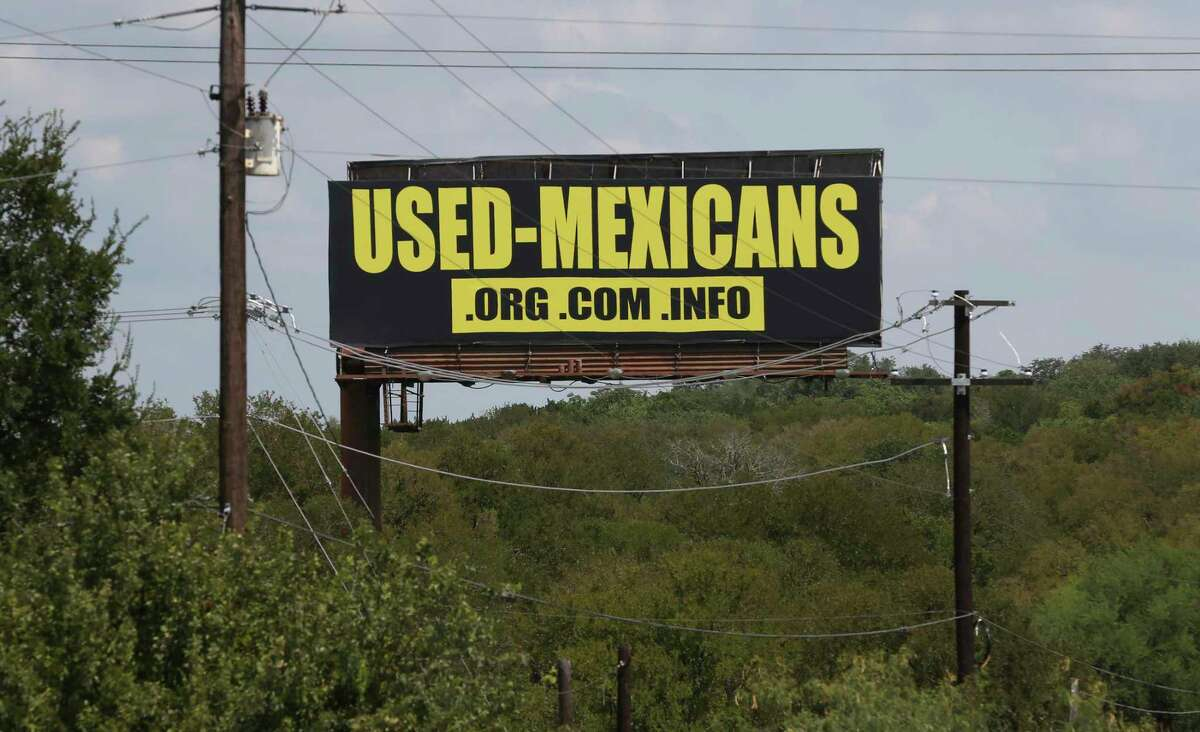A billboard along Interstate 35 between New Braunfels and San Marcos was taken down Monday after the owner of the sign learned of its content, an official said.