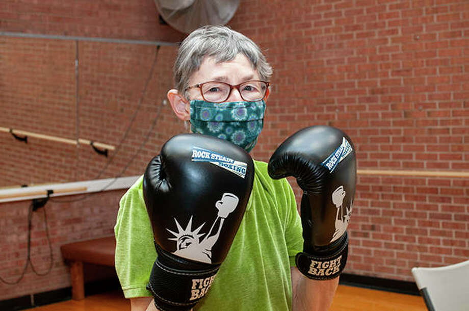 Fran Ringle (green shirt) has been battling Parkinson's disease for three years. Last year, both Fran and her husband, Jim, started attending the Rock Steady Boxing class at Bob Freesen YMCA. The class helps people with Parkinson's work on coordination, hand movement, balance and overall health. Photo: Darren Iozia   Journal-Courier