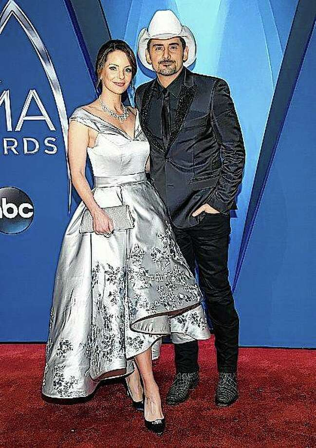 Actress Kimberly Williams-Paisley (left) and country musician Brad Paisley arrive Nov. 8, 2017, at the 51st annual CMA Awards in Nashville, Tennessee. The couple has pledged to donate 1 million nutritional meals in various cities around the country. The initiative is billed as the Million Meal Donation Tour. Photo: Evan Agostini | Invision | AP
