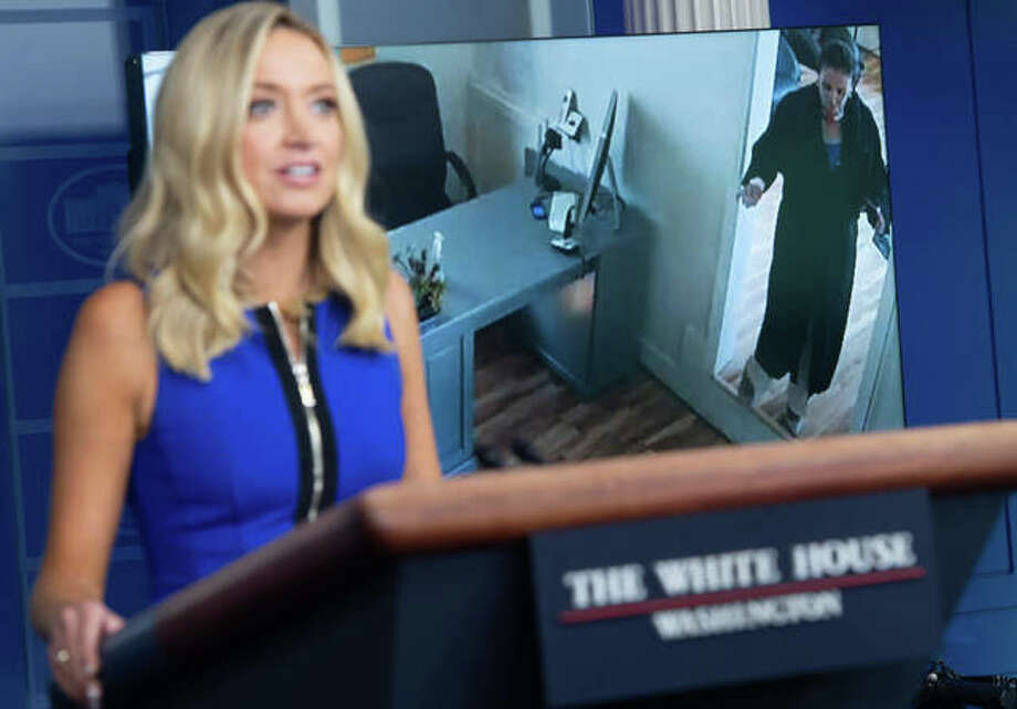 White House Press Secretary Kayleigh McEnany speaks while a video plays of Speaker of the House Nancy Pelosi walking into a hair salon. Photo: Photo By Saul Loeb | AFP
