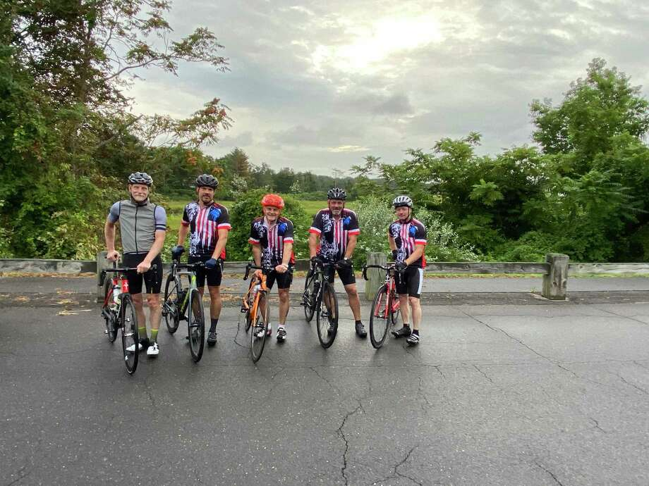Colonel Charlie Anderson with a group of friends bicycle ride to raise funds to create and install a granite memorial bench at Camp Nett. Photo: Contributed Photos