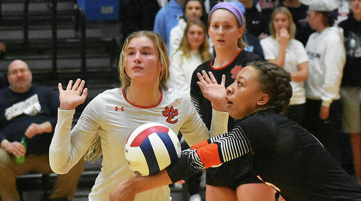 Edwardsville's Alexa Harris receives a serve in front of Emma Garner in the second game against Althoff last season.