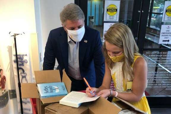 "Congressman Michael McCaul and cancer survivor Sadie Keller visit Texas Children's Hospital to distribute signed copies of Keller's book, ""Better Angels"" on Sept. 2, 2020."