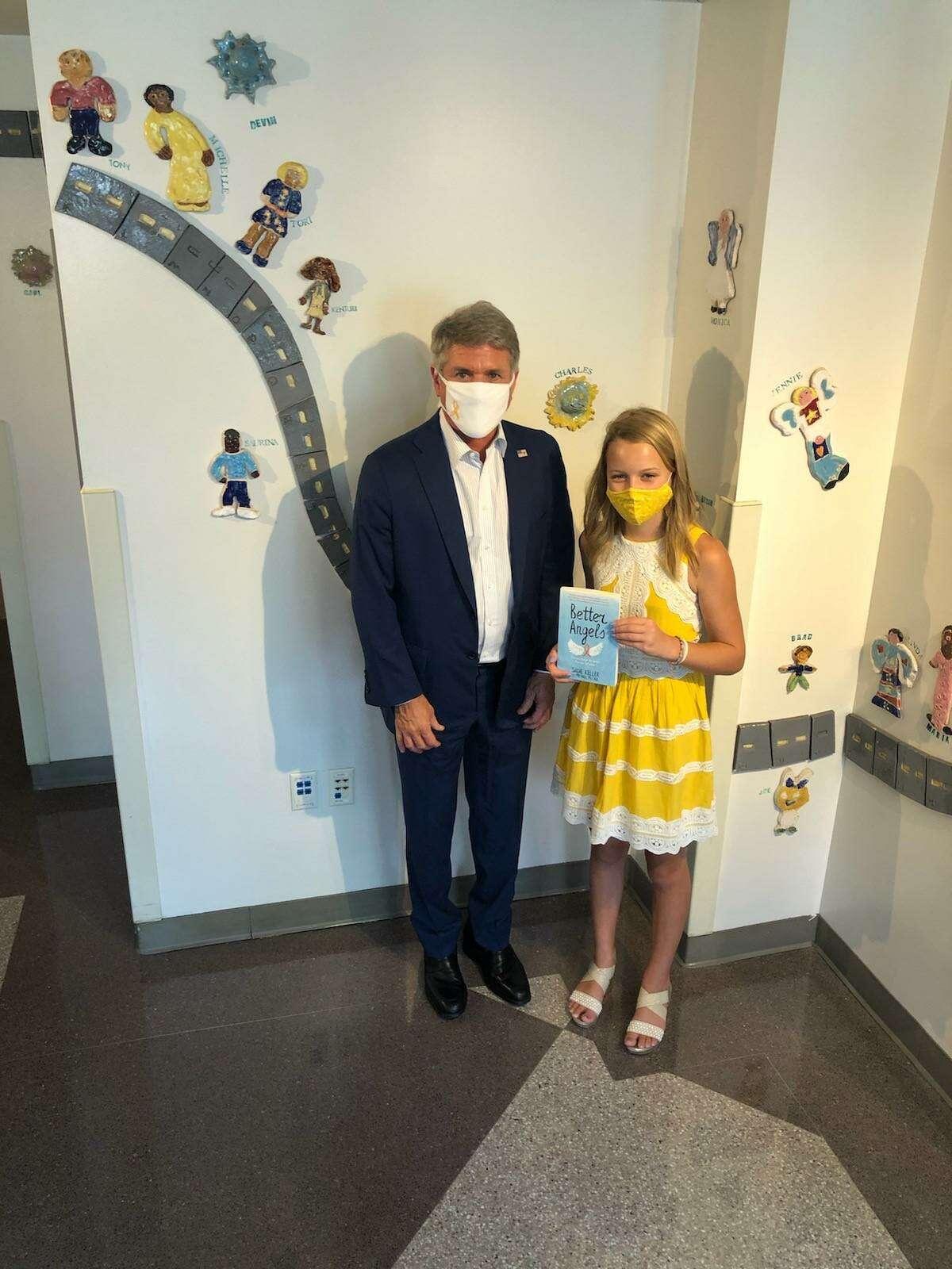 Congressman Michael McCaul and cancer survivor Sadie Keller visit Texas Children's Hospital to distribute signed copies of Keller's book,