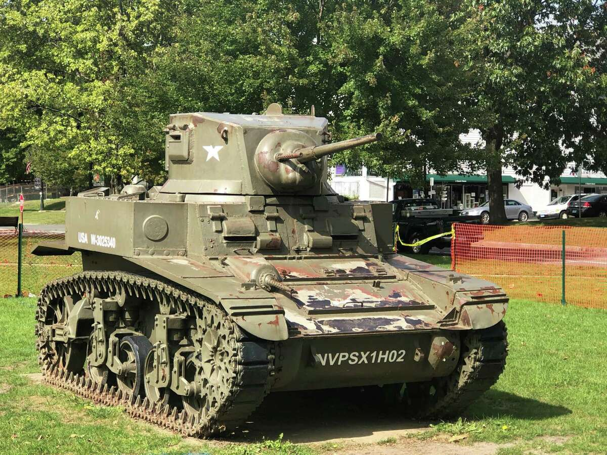 Volunteers from New Milford, as well as businesses and town agencies are collaborating on the restoration of the tank on the Village Green.