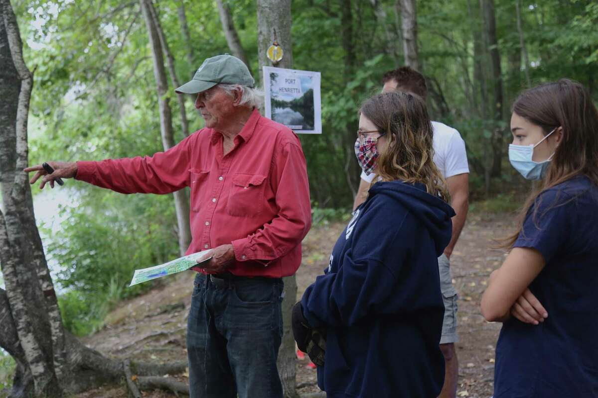 Chris Filmer, president of the Friends of Selleck's Woods, explains to some student volunteers how they can help.