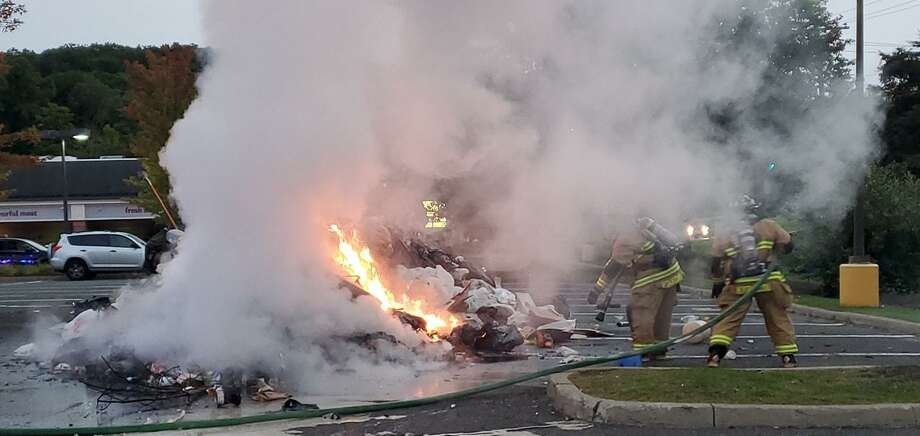 Firefighters put out a blazing pile of garbage in the parking lot of Stop & Shop Tuesday morning. Photo: New Fairfield Volunteer Fire Department