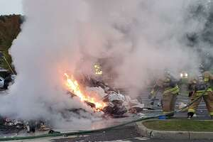 Firefighters put out a blazing pile of garbage in the parking lot of Stop & Shop Tuesday morning.
