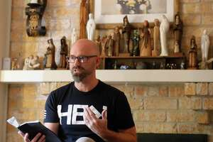 Justin Ulmer delivers a message as members of Little Flock Church gather at Ulmer's home, Sunday, Sept. 13, 2020, in The Woodlands. Ulmer, a former student pastor, helps guide four separate meetings and plans to move to south Conroe soon.