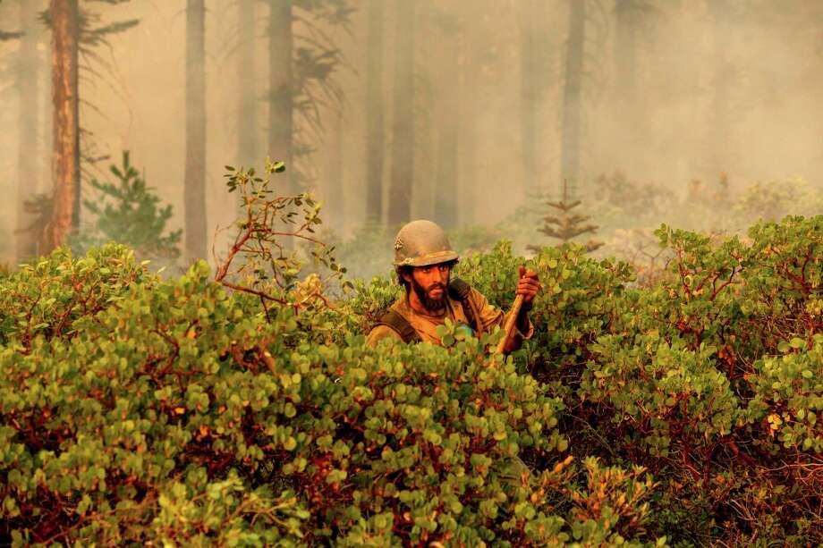 Firefighter Cody Carter battles the North Complex Fire in Plumas National Forest, Calif., on Monday, Sept. 14, 2020. (AP Photo/Noah Berger) Photo: Noah Berger / Associated Press / Noah Berger