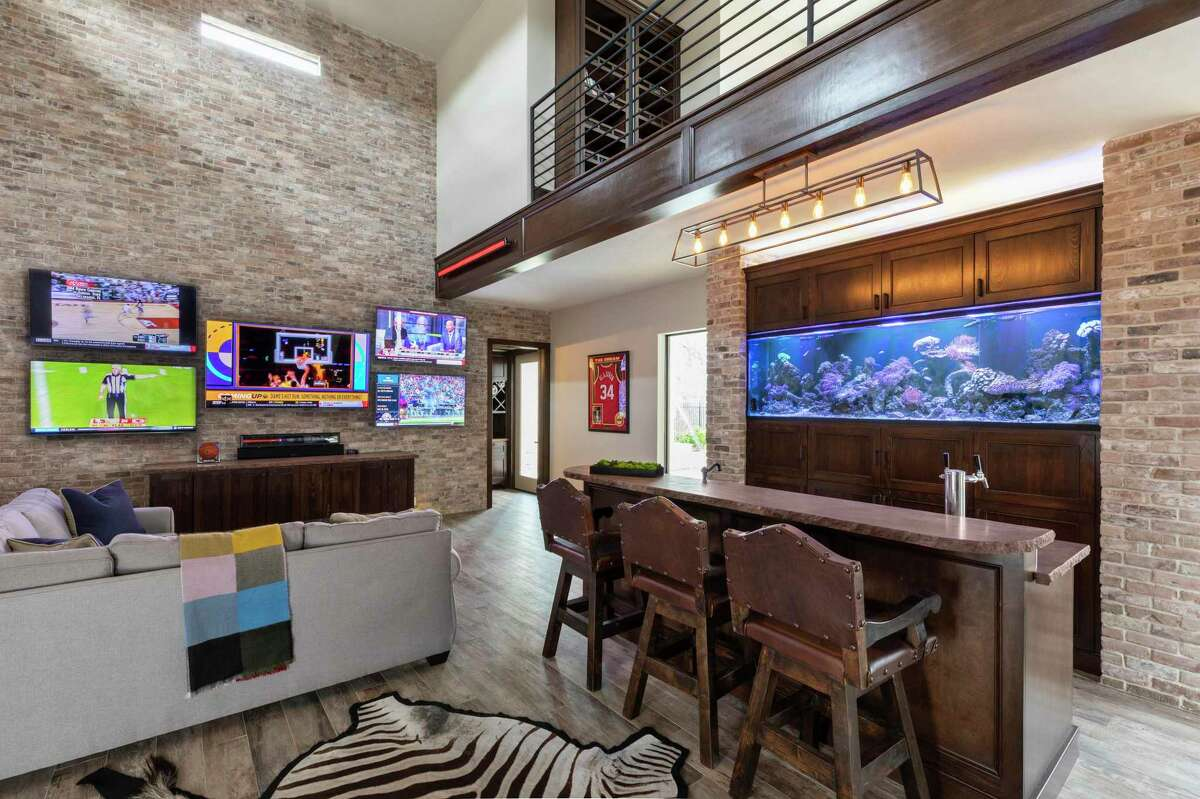 Inside the manplex, a 400-gallon saltwater fish tank and five large TVs are Matt's pride and joy.