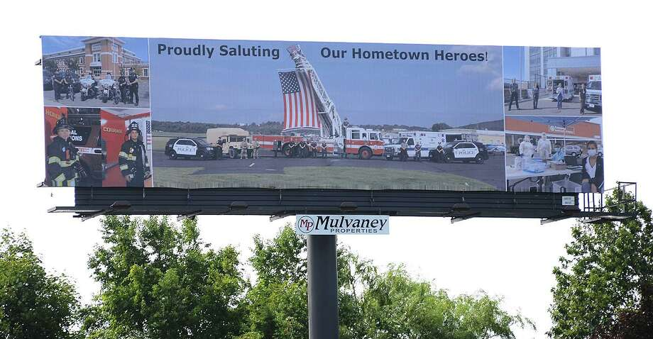A billboard installed in Danbury on the eastbound side of I-84 near the New York state line thanks local police, fire and health care workers, as well as National Guard members for their efforts during the coronavirus pandemic. Photo: Contributed Photo / J.C. Martin Photos / The News-Times Contributed