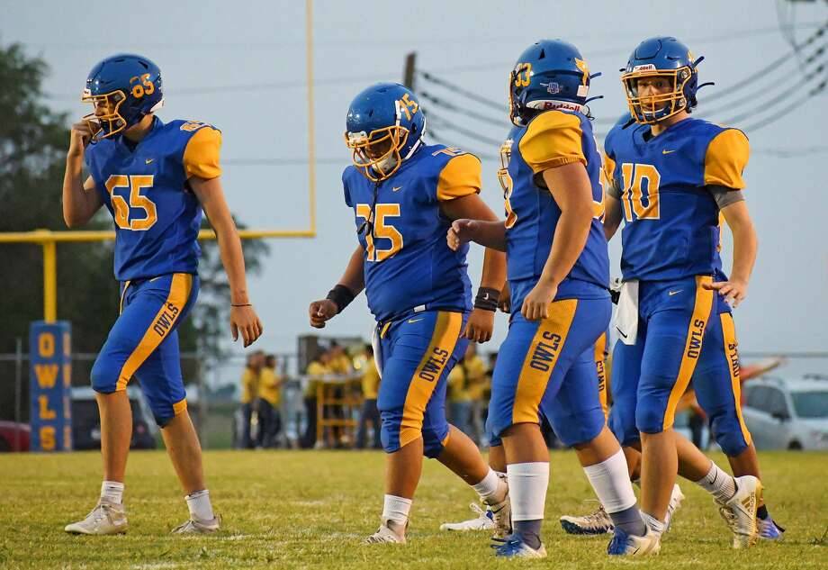 Hale Center's Hunter Thompson (10) talks strategy with Justin Castillo (33) while Drew Smith (65) and Johnny Garcia head back out on offense during their non-district high school football game against Memphis on Sept. 11, 2020 at Hale Center. Photo: Nathan Giese/Planview Herald