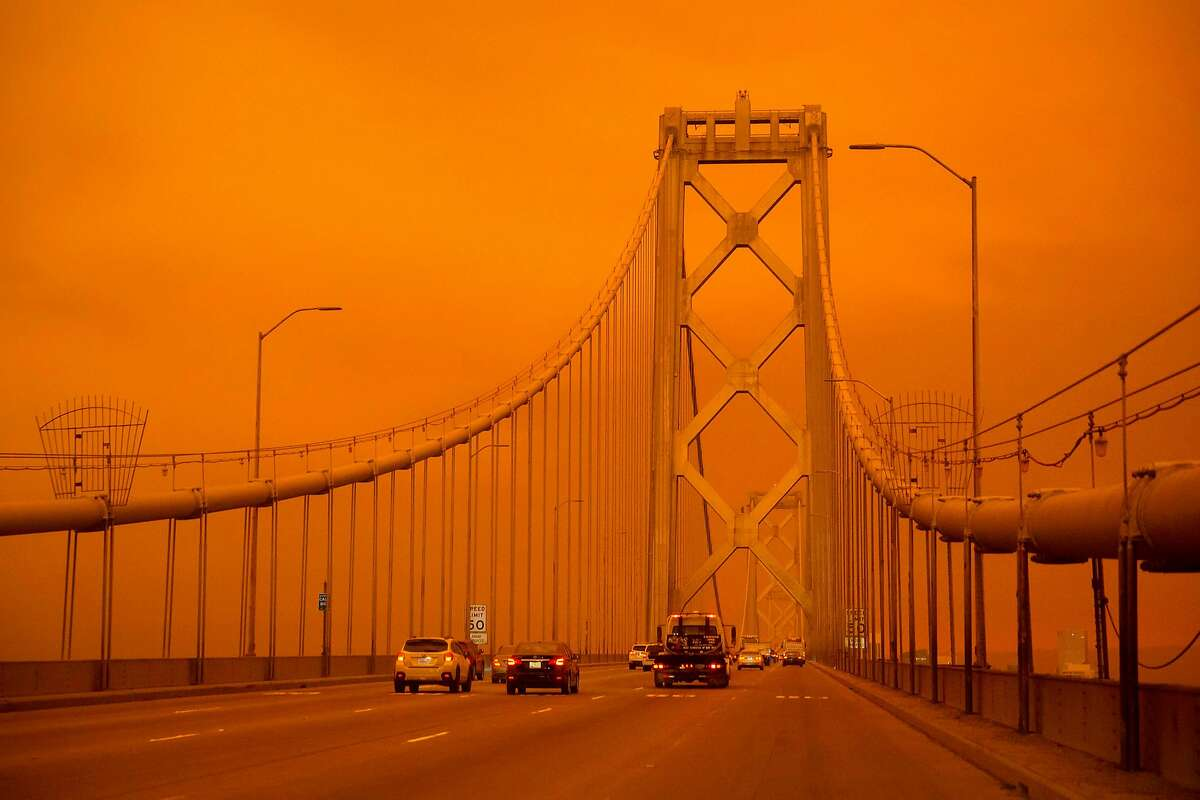 Cars drive along the Bay Bridge under a smoke-filled sky in San Francisco  on Sept. 9, 2020.