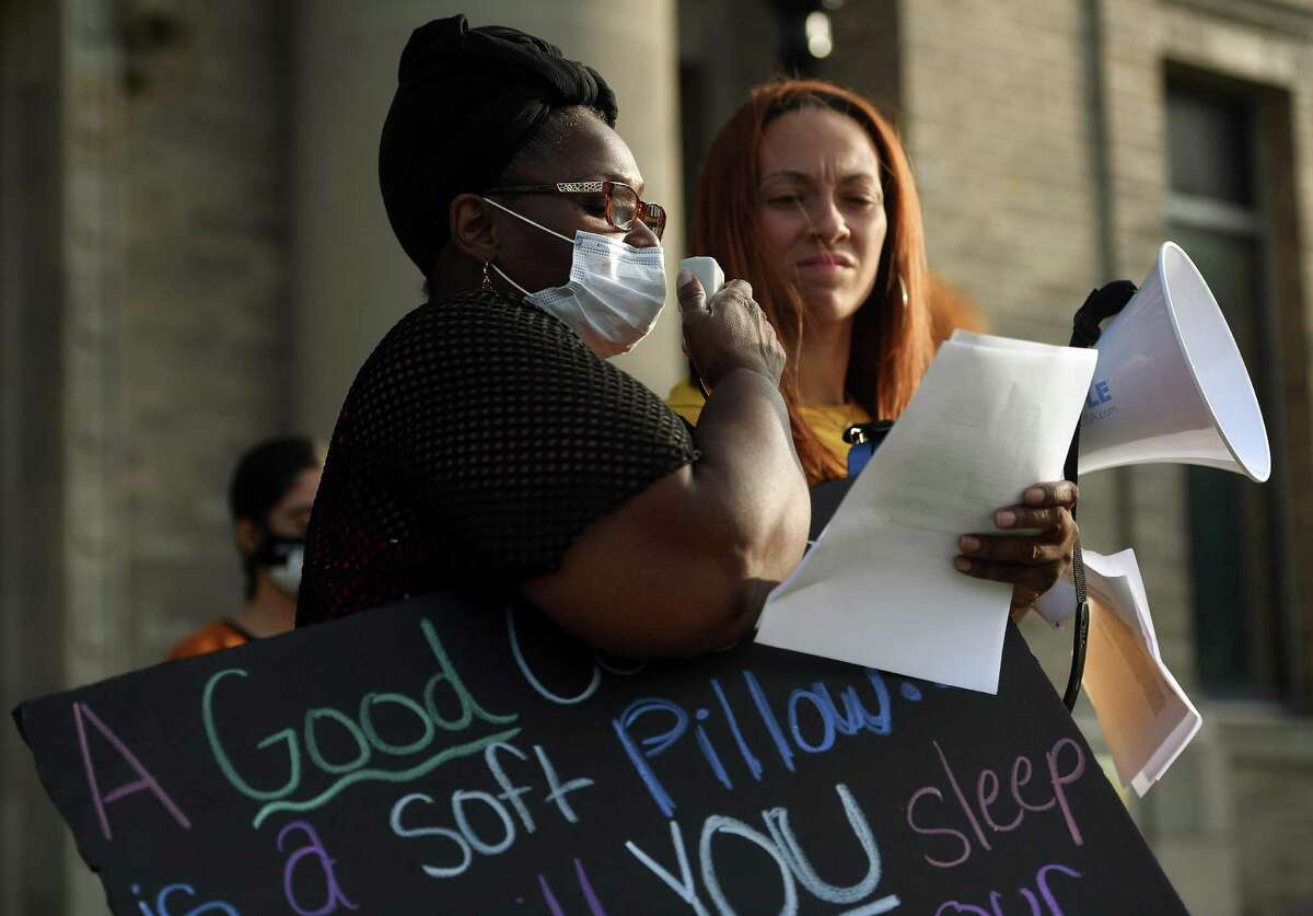 Activists Wanda Simmons, left, and Mikaela Adams read statements from Bridgeport teachers of their safety concerns during a rally outside City Hall in Bridgeport, Conn. on Monday, September 14, 2020. Teachers claim that Superintendent Testani has promised repercussions if they participated in protests.