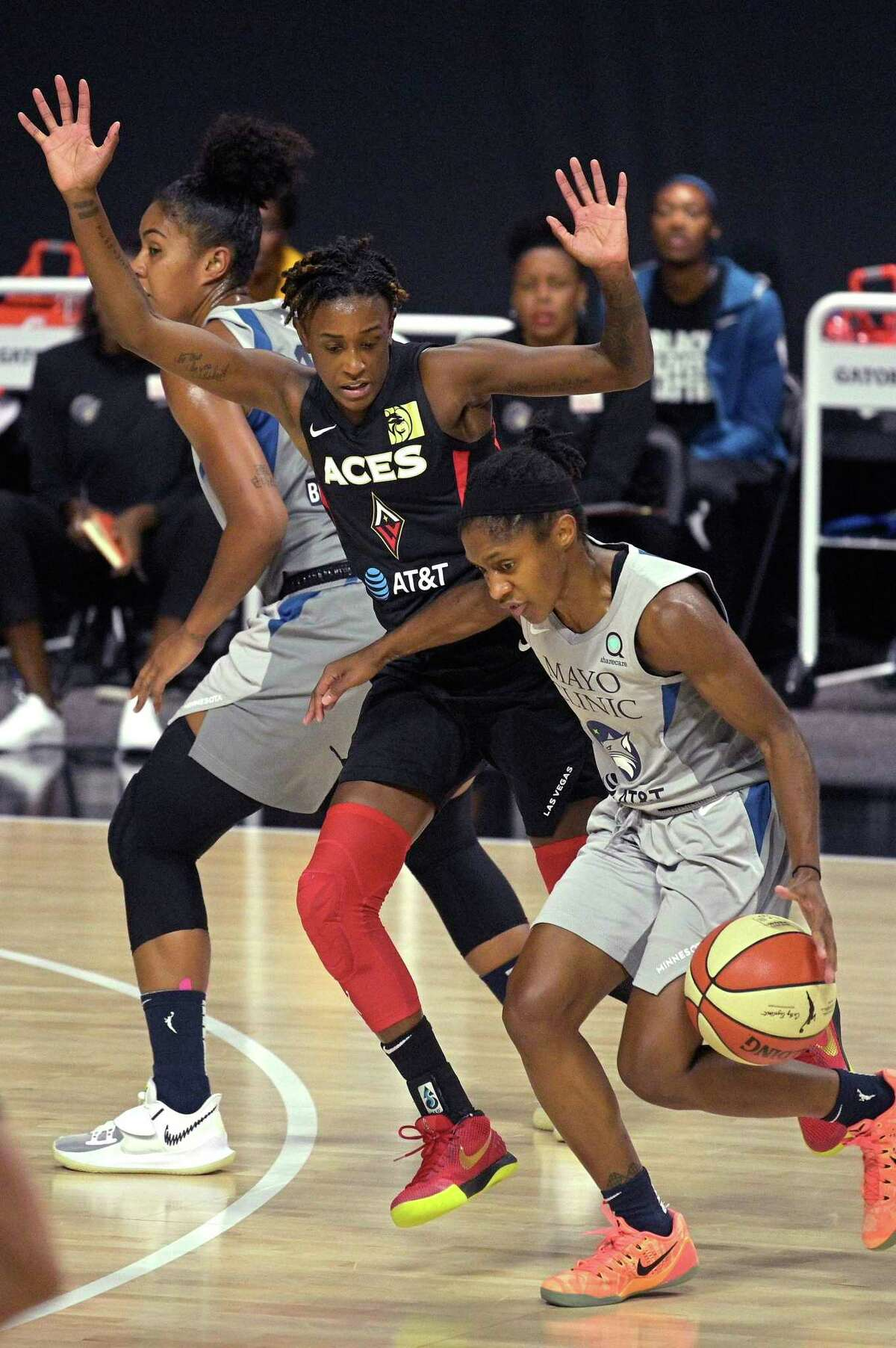 Minnesota Lynx guard Crystal Dangerfield, right, is fouled by Las Vegas Aces guard Danielle Robinson while driving to the basket during the first half of a WNBA basketball game Thursday, Sept. 10, 2020, in Bradenton, Fla.